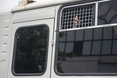 Protest held in Moscow over arrest of investigative journalist Ivan Golunov. man looks through bars of a police avtozak - Car for