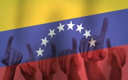 Protest Hands on the background of the Venezuela flag. Freedom concept.  stock photography
