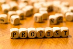 Protest lettering written with wooden cubes stock photos