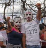 Protest March Tegucigalpa Honduras November 2017 4. A couple wearing mask on a protest in Tegucigalpa Honduras central america stock photos
