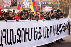 Protest march in Yerevan. YEREVAN, ARMENIA – JANUARY 18: Activists and opposition protesting against a controversial new obligatory pension scheme , shown on Stock Photos