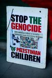 Protest messages at the Gaza: Stop The Massacre rally in Whitehall, London, UK. stock photography