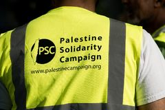 Protest messages on placards and posters at the Gaza: Stop The Massacre rally in Whitehall, London, UK. Hundreds of protesters with placards gathered for the Royalty Free Stock Photography