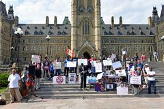 Protest in Ottawa to mark anniversay of crackdown on Rohingya in. Ottawa, Canada - August 25, 2018: A crowd gathers on Parliament Hill to mark and protest the stock images