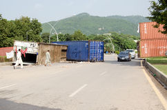 Protest Road Block, Islamabad. ISLAMABAD, PAKISTAN - SEPTEMBER 24, 2014:  A road block made by protesters with shipping containers and piles of stones in the Stock Image