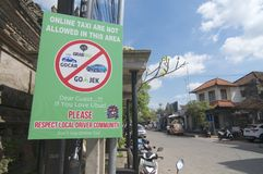 Protest sign against online taxi services in Ubud, Bali. Ubud, Bali, Indonesia - 17th May 2019 : Protest sign place from local people in Ubud against the online royalty free stock photography