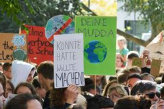 Protest sign saying `Could. Might. Would. Do!` in German held up by young people during Global Climate Strike / Fridays for future