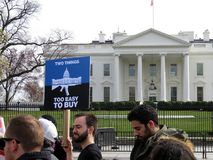 Protest Sign and White House. Photo of protest sign and white house at the march for lives rally in downtown washington dc on 3/24/18. This sign protests against stock image
