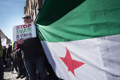 Protest signs against the war in Syria at demonstration. Activists hold signs calling to stop the war in Syria during the annual May Day march in Oslo, Norway Stock Image
