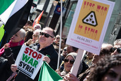 Protest signs against the war in Syria at demonstration. Activists hold signs calling to stop the war in Syria during the annual May Day march in Oslo, Norway Royalty Free Stock Photos