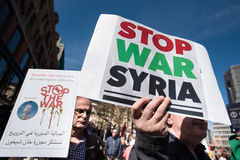 Protest signs against the war in Syria at demonstration. Activists hold signs calling to stop the war in Syria during the annual May Day march in Oslo, Norway Royalty Free Stock Photo