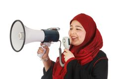 Protest with a smile. Young veiled woman protesting with use of a megaphone Royalty Free Stock Photos