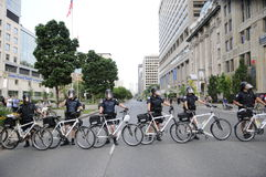 Protest in Toronto. TORONTO-JUNE 25: Toronto Cycle Police restricting the protesters from entering the actual G20 summit perimeter on University Avenue during Royalty Free Stock Photo