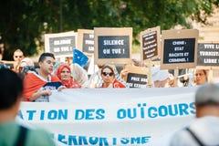 Protesta de los activistas de los derechos humanos de Uyghur Foto de archivo libre de regalías