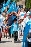 Protesta de los activistas de los derechos humanos de Uyghur Foto de archivo