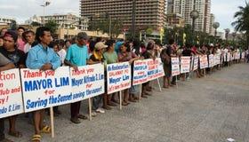 Protesta dell'orologio di tramonto per la baia di Manila, Manila Fotografia Stock Libera da Diritti