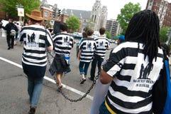 Protesta di immigrazione: Non c'è nessun essere umano illegale Immagini Stock