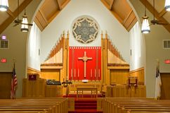 Protestant church chancel. A view of the chancel, altar, pipe organ and pulpit area of a modern Protestant church sanctuary Stock Photo