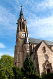 Protestant church with a clock on the tower Stock Photo