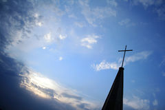 Protestant church top cross in the sky Stock Images
