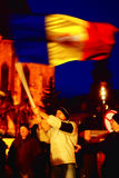Protestant with romanian flag. In Cluj Napoca, Romania, hundreds of people are still protesting every day against the government. Photo taken on Saturday, 21 Stock Photos
