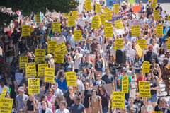 Protestants in the streets with signs Royalty Free Stock Image