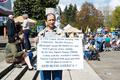 Protestataire de réception de thé qui s'est échappé du communisme. Images stock