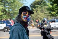 Protestateur masqué photographie stock