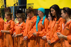 Protestation d'activistes d'Amnesty International chez Potsdamer Platz Image libre de droits