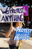 A Protester Against Protests Carries Signs In Oddball Miami Parade Royalty Free Stock Photos
