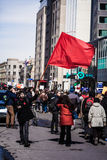 Protester Agitating a Red Flag in the Street Royalty Free Stock Photos