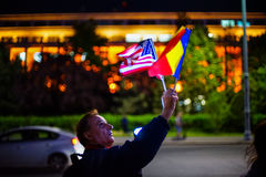 Protester with american and romanian flag, Bucharest, Romania Royalty Free Stock Images