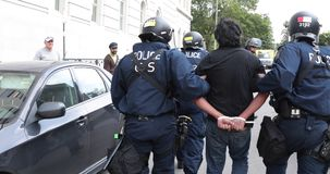 Protester being arrested by riot police.