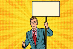 Protester businessman with a placard at the rally. Pop art retro vector illustration Royalty Free Stock Image