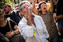 Protester in a demostration against spanish nationalism. Independentist protester mocking to a spanish nationalist not in camera royalty free stock photography