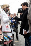 Protester filmed at Anti UKIP protest in Thanet South. Protester dressed as doctor interviewed by Catalan TV at Anti UKIP protest in Ramsgate, Thanet South Stock Photo