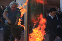 Protester on fire from molotov coctail Royalty Free Stock Image
