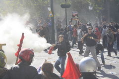 Protester fires extinguisher at other protesters Stock Photo