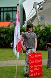 Protester with flag and placard: Singapore rally Royalty Free Stock Photo