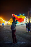 Protester holding romanian flag, Bucharest, Romania Royalty Free Stock Image