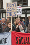 A protester holds a placard saying Don't Copy The Stock Photo