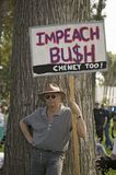 A protester holds a sign reading Impeach Bush at an anti-Iraq War protest march in Santa Barbara, California on March 17, 2007 Royalty Free Stock Images