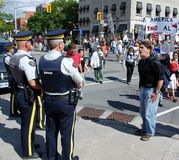 Protester hollers at Mounties Royalty Free Stock Image