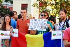 Protester i den Oradea staden mot cyanidguld som gräver i Rosia Montana i Rumänien Arkivbild