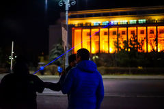 Protester pointing laser on government building in Bucharest, Romania Royalty Free Stock Photos