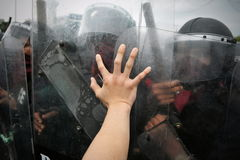 Protester and Police. Protester Pushes Police Riot Shield Stock Photography