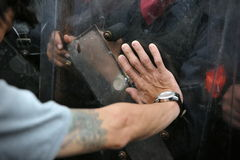 Protester and Police. Protester Pushes on Riot Police Shield Stock Images