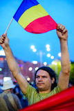 Protester raising flag, Bucharest, Romania Stock Image