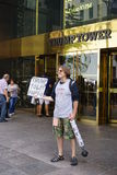 A protester sellingTrump toilet paper in front of the Trump Tower in New York. NEW YORK, NY - A protester against Republican nominee Donald Trump sells Trump Royalty Free Stock Photography