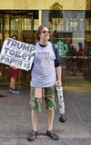 A protester sellingTrump toilet paper in front of the Trump Tower in New York. NEW YORK, NY - A protester against Republican nominee Donald Trump sells Trump Royalty Free Stock Photos